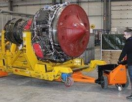Pedestrian tug moving a 6000Kg thruster for reconditioning in the Aerospace industry