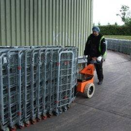 Dairy roll cage mover