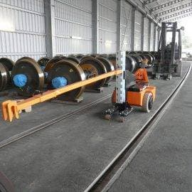 Extension coupling to reach over service pit
