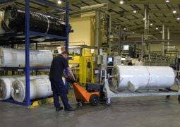 Moving a 3000kg textile roll on an A-frame trolley