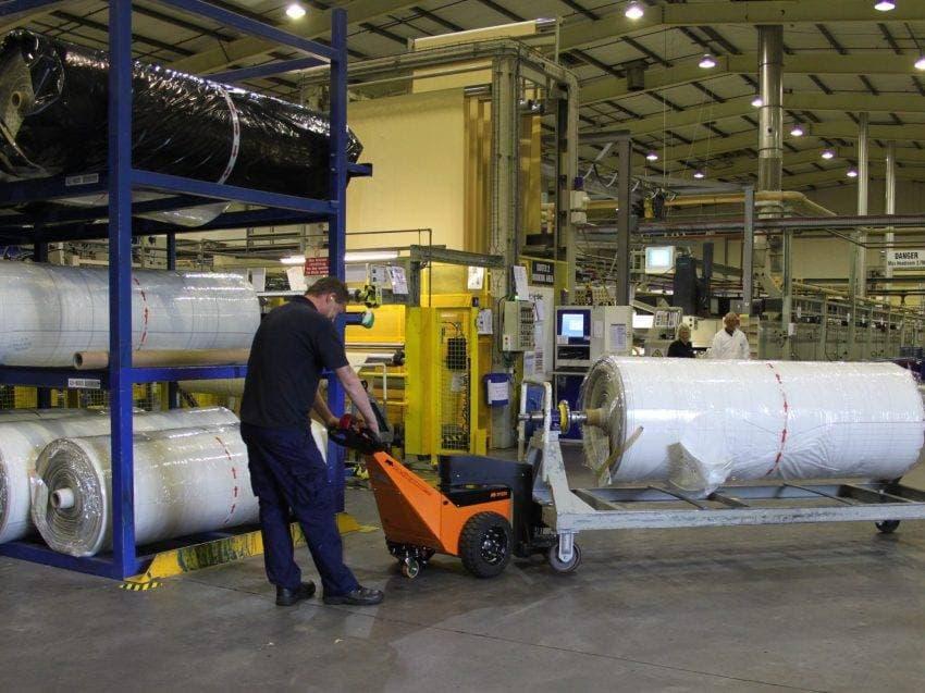 Pedestrian tug moving 3000kg textile roll