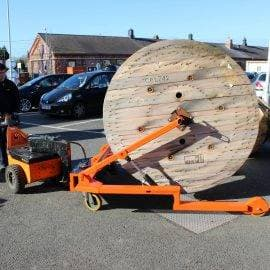 Pedestrian tug cable drum trolley