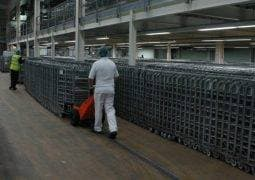 TET Pedestrian Pusher moving dairy roll cages